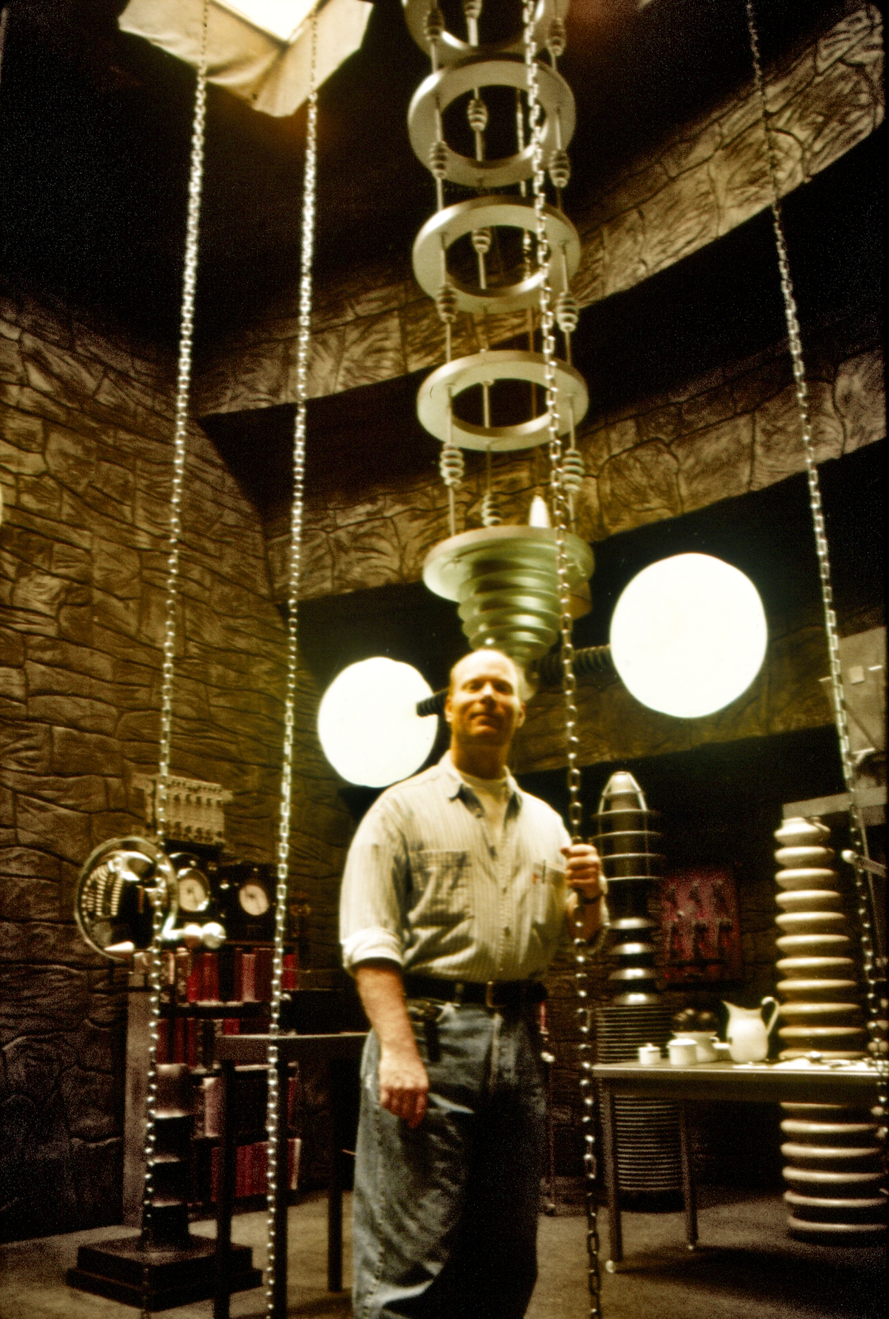 115, co-executive producer Sam Irvin standing on the BRIDE OF FRANKENSTEIN laboratory set that was recreated for GODS AND MONSTERS.